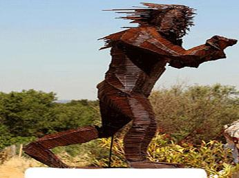 1 Angry brown man sculpture taking revenge on women