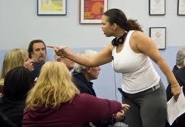 woman bribing a guard