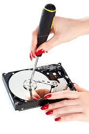 woman repairing electronic items