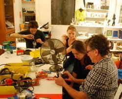 woman repairing fan