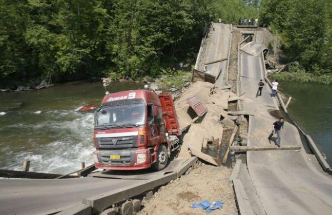 Truck on broken bridge