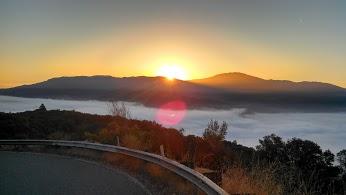 sun peeping from mountain