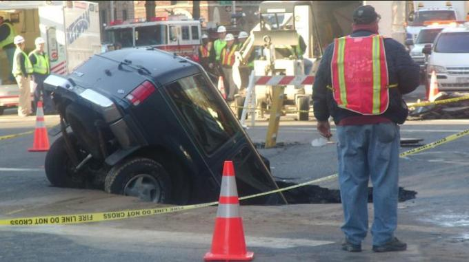 8g car in sink hole