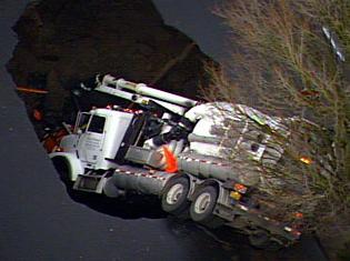 21a truck in sinkhole