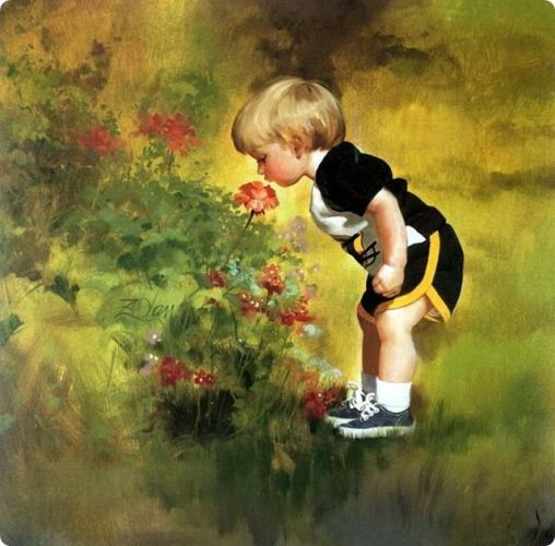 2 Boy smelling the Flower