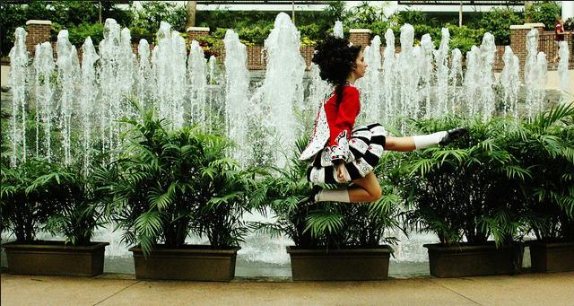 9n Irish girl dancing beside the fountain