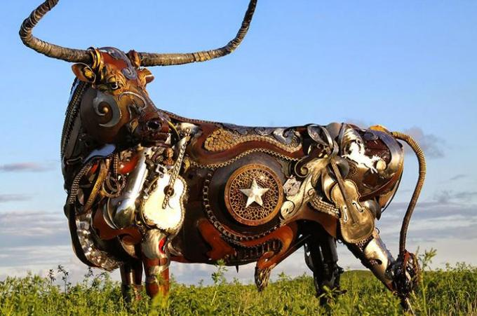 Cow in metal scrap