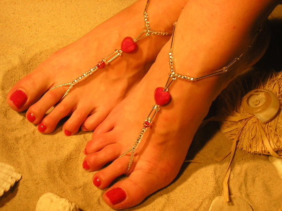 Red nail polish with precious stones