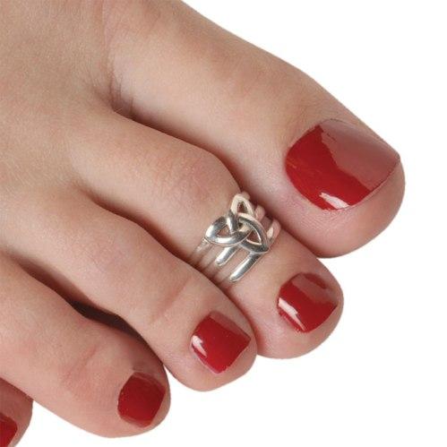 Toe ring on red nail polish