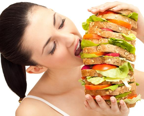 woman overeating huge burger meat bread