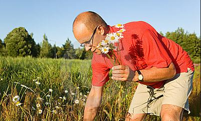 1 Man plucking flower in red T shirt