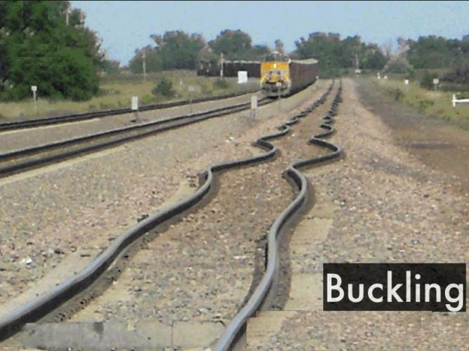 3a Rail line bent buckled by heat